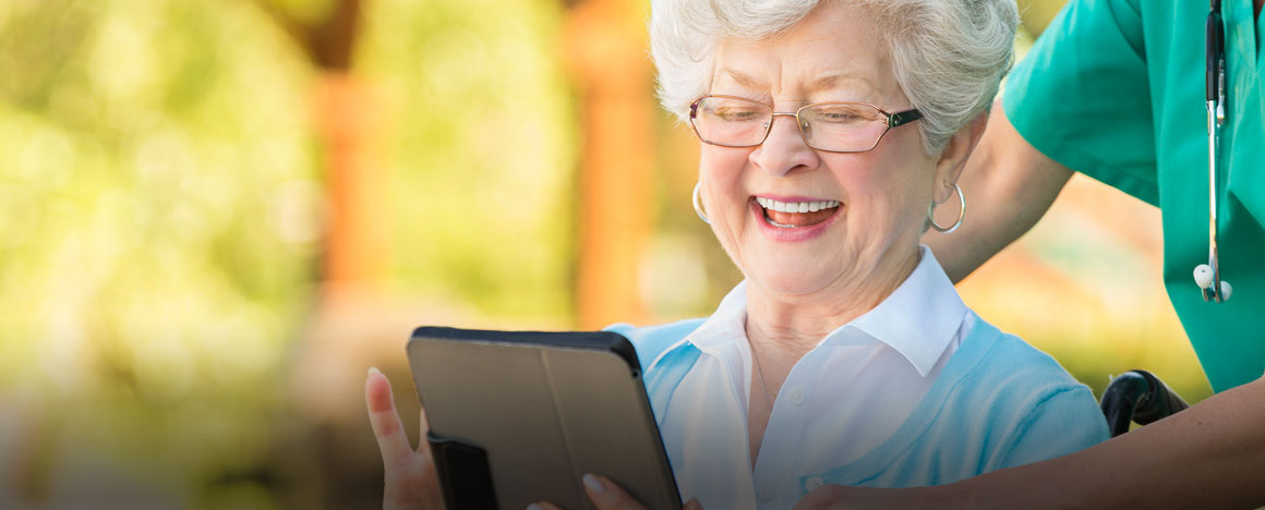 Proud-senior-woman-learns-to-use-a-digital-tablet
